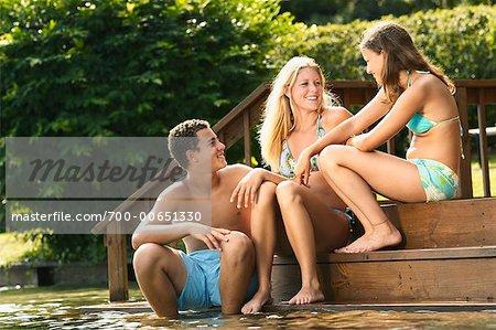 Teens Sitting on Deck