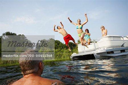 Teens Jumping off Boat
