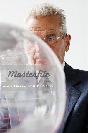 Man Looking Through Globe