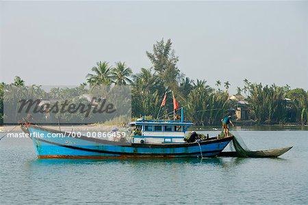 Fishermen Working on Fishing Boat, De Vong River, Hoi An, Vietnam