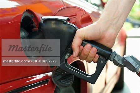 Close Up of Man Filling Gas Tank