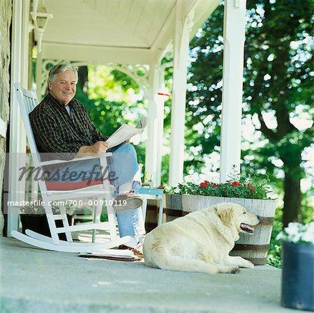 Phenomenal Man And Dog On Porch Stock Photo Masterfile Rights Frankydiablos Diy Chair Ideas Frankydiabloscom