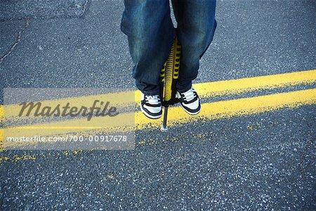 Close Up of Boy Jumping On a Pogo Stick
