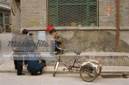 Men Playing Game on Sidewalk, Pingyao, China