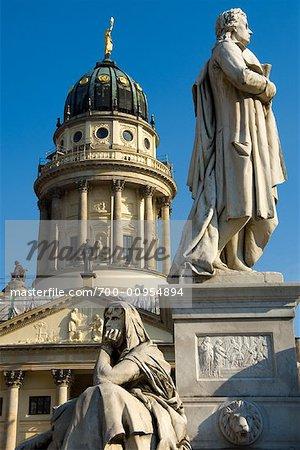 Statues in Gendarmenmarkt, German Cathedral in Background, Berlin, Germany