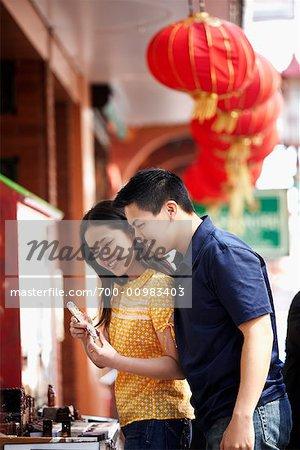 Couple Looking at Store Display, Kearny Street, Chinatown, San Francisco, California, USA