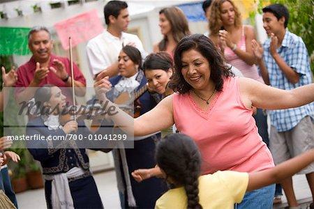 Woman and Girl Dancing at Family Gathering