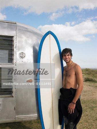 Portrait of Man Holding Surfboard