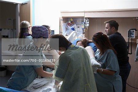 Pregnant Woman Giving Birth - Stock Photo - Masterfile