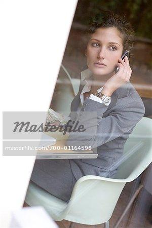 Businesswoman in Restaurant, Using Cellular Phone