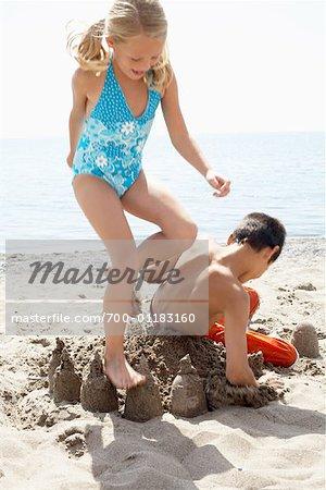 Children Destroying Sandcastle