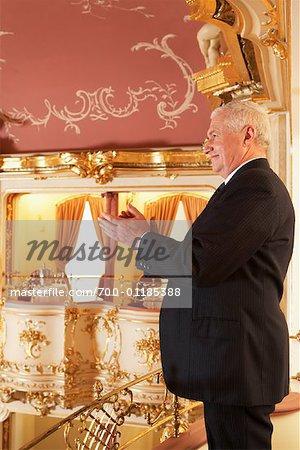 Man Applauding at the Opera