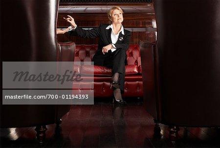 Business Woman Ashing Cigar on Hand
