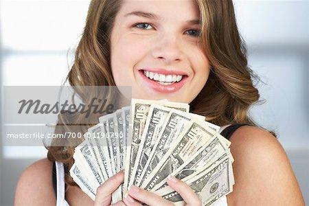 Portrait of Girl Holding Cash