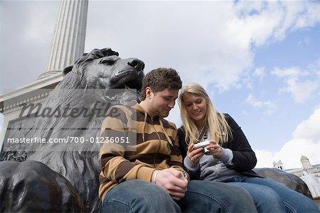 Couple in Trafalgar Square, London, England