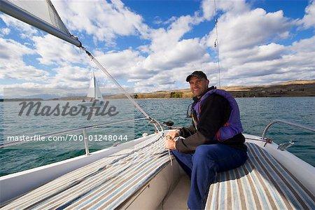 Man Sailing, Ghost Lake, Alberta, Canada