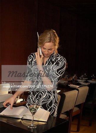 Restaurant Hostess Making Reservations