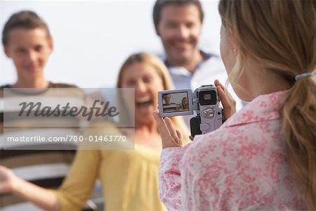 Girl Taking Video of Family