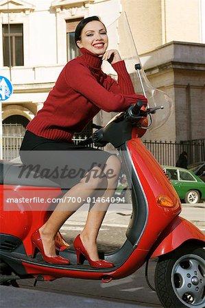 Woman Sitting on Vespa