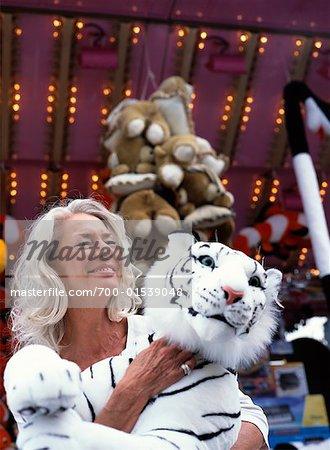 Woman at Amusement Park, Holding Stuffed Animal