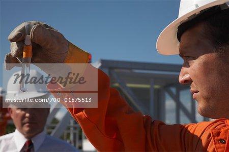 Worker Holding Test Tube