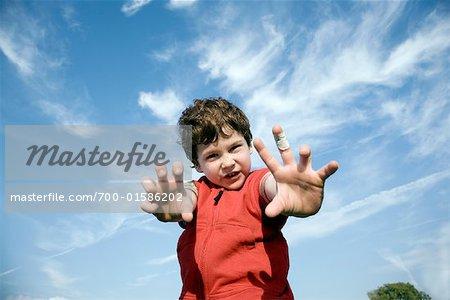 Boy Reaching Towards Camera