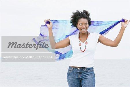 Woman Holding Scarf on Beach