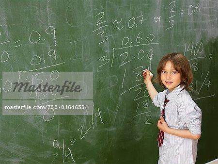 Child Doing Math on Chalkboard