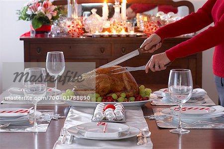 Woman Carving Christmas Turkey