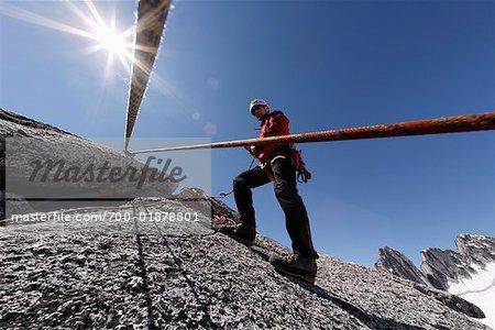 Man Rock Climbing in Mountains, Bugaboo Mountains, British Columbia, Canada