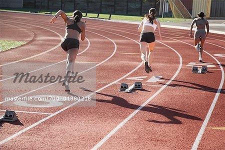 Women Racing on Race Track
