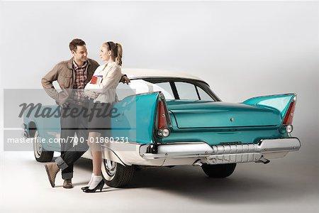 Couple Standing Next to 1957 Dodge Regent