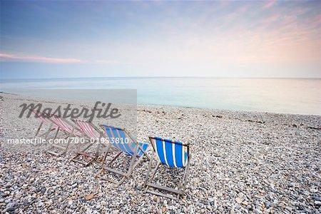 Folding Chairs on Beach, Beer, Devon, England