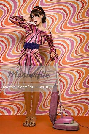 Woman Vacuuming in Vintage Setting