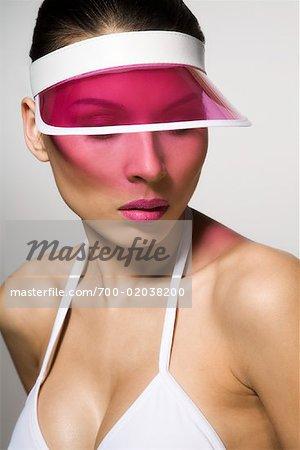38938da3 Portrait of Woman Wearing Sun Visor - Stock Photo - Masterfile ...