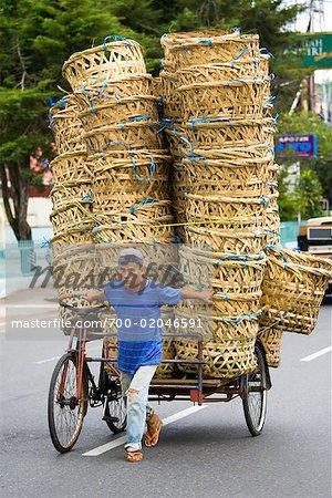 Man Pulling Rickshaw with Baskets, Bukittinggi, Sumatra, Indonesia