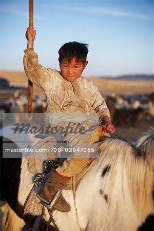 Portrait of Little Boy on Horseback, Mongolia