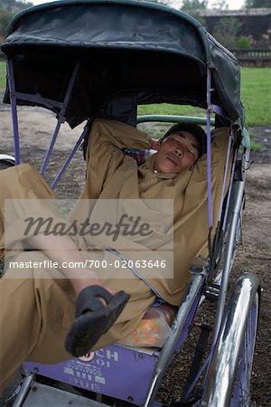 Man Sleeping in Rickshaw, Hue, Vietnam