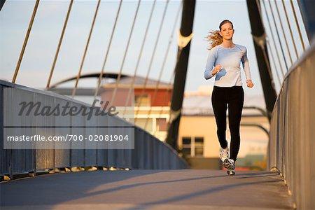 Woman Jogging on City Bridge, Portland, Oregon, USA