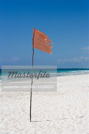 Flag on Beach, Tulum, Mexico