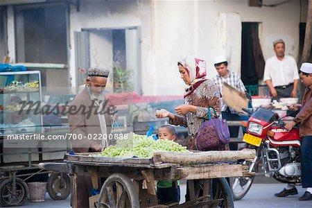 Family Shopping at Market, Kashgar, Xinjiang, China