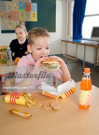 Boy Eating Fast Food Lunch
