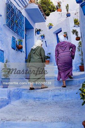 Women Walking up Stairs, Chefchaouen, Morocco