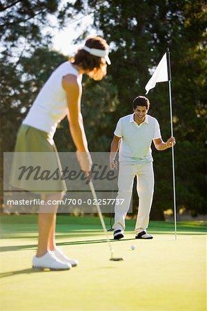 Couple Playing Golf, Salem, Oregon, USA
