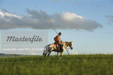 Horseman in Field, Inner Mongolia, China