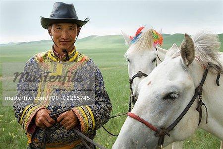 Man With Horses at the Naadam Festival, Xiwuzhumuqinqi, Inner Mongolia, China