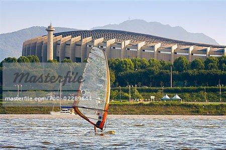 Windsurfer in Front of Olympic Stadium, Han River, Seoul, South Korea