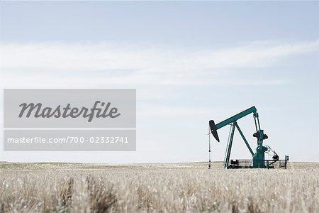 Oil Drill in Field, Alberta, Canada