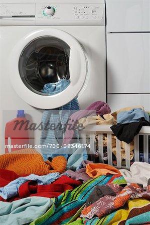 Clothing Piled Up Outside of Washing Machine