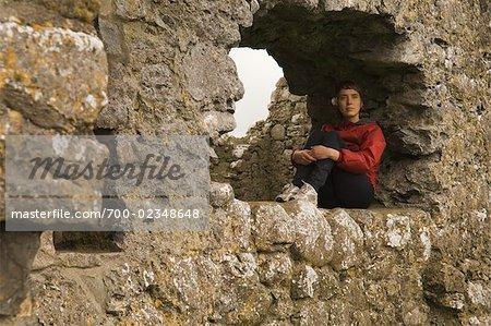 Woman Sitting in Window of Kilmacduagh Monastery, Kilmacduagh, County Galway, Ireland
